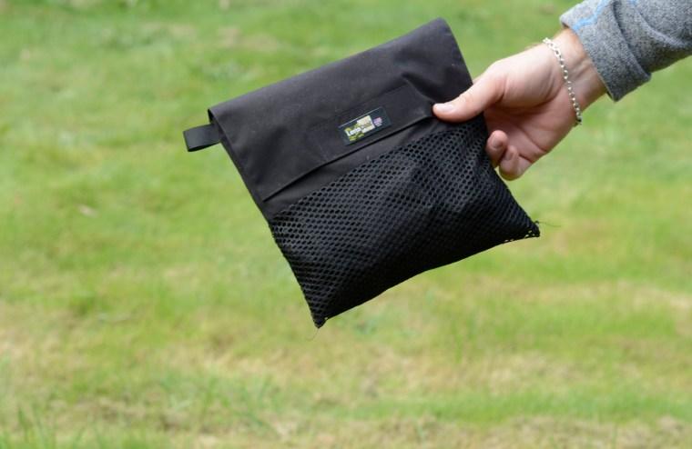 Lens Coat pakket sammen i praktisk pose