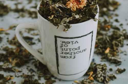 white and brown ceramic mug