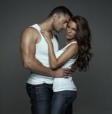 Sensual man hugging beautiful young woman