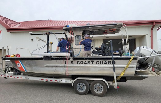 The team integrating the MIST kit on the USCG aids to navigation boat.