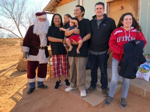 Family with Navajo Santa and volunteers