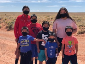 Family wearing COVID-19 masks