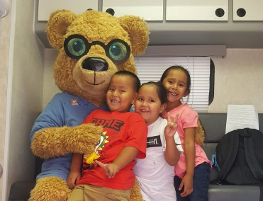 Young children with Eye Care for Kids Bear
