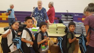 Young students picking out school supplies