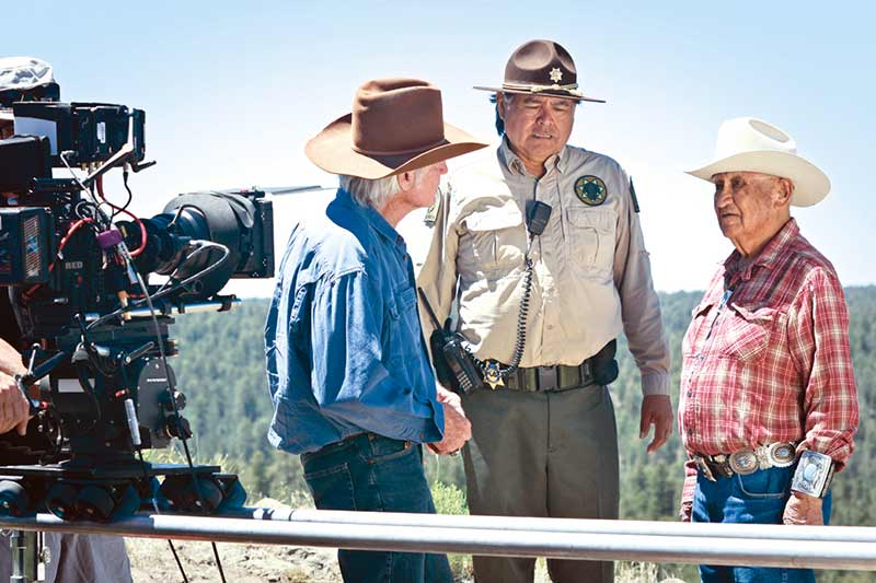 """A scene is filmed that includes """"Sibley"""" (Chris Robinson), """"Bahe"""" (James Bilagody) and """"Chei"""" (Thomas H. Begay) for the film """"Legends from the Sky."""" (Courtesy photo)"""