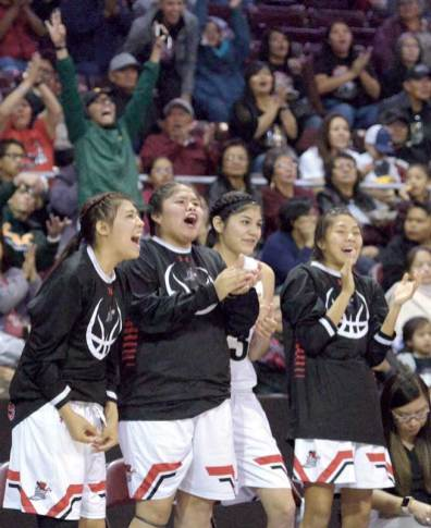 Navajo Times | Donovan Quintero The Page Lady Sand Devil bench begin to celebrate their victory over the Safford Lady Bulldogs Monday in Prescott Valley, Arizona.