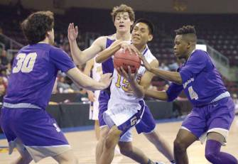 Navajo Times | Donovan Quintero Blue Ridge Yellowjacket Darrien Burnette, white jersey, powers his way through a trio of Sabino Sabercat defenders Tuesday night during the Arizona 3A boys state quarterfinals at the Prescott Valley Events Center in Prescott Valley, Arizona.