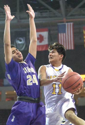 Navajo Times | Donovan Quintero Yellowjacket Corey Endfield (11) sets up the ball as he drives it to the basket Tuesday at the Prescott Valley Events Center.