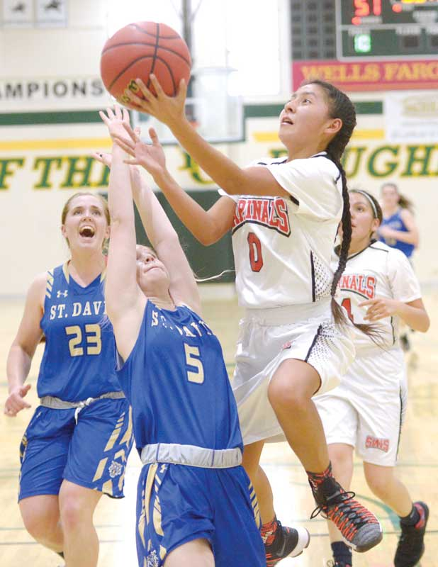 Navajo Times | Donovan Quintero St. Michael Lady Cardinal Ali Upshaw (0) sets up for a two-point attempt against guarding St. David Lady Tiger Brylee Murray (5) Saturday in the Arizona 1A girls state quarterfinals at Yavapai College in Prescott, Arizona.