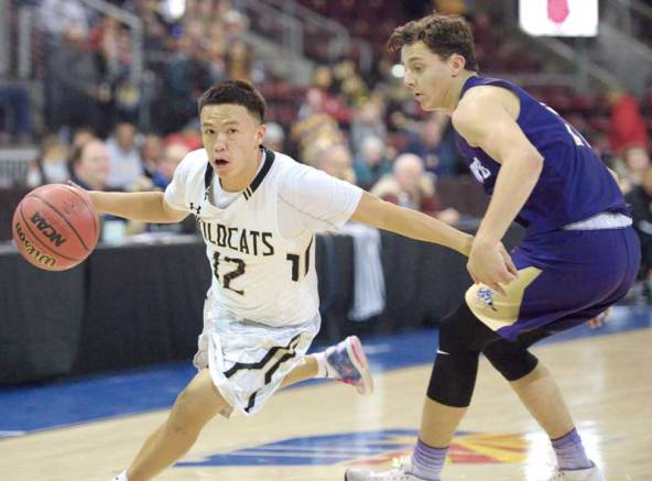 Navajo Times | Donovan Quintero Chinle Wildcat Josiah Tsosie drives the ball against a Wickenburg defender Tuesday in the Arizona 3A boys state quarterfinals at the Prescott Valley Events Center in Prescott Valley, Arizona.