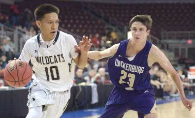 Navajo Times | Donovan Quintero Wildcat Cooper Burbank (10) pushes a Wickenburg defender's arm off of him as he drives the ball for the basket Tuesday at the Prescott Valley Events Center in Prescott Valley, Arizona.