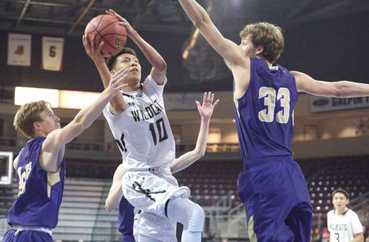 Navajo Times | Donovan Quintero Chinle Wildcat Cooper Burbank (10) avoids being blocked by a duo of Wickenburg defenders as he drives for the basket Tuesday during the Arizona 3A boys state quarterfinals at the Prescott Valley Events Center in Prescott Valley, Arizona.
