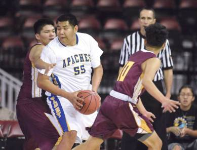 Navajo Times | Donovan Quintero Fort Thomas Apache Latrell Titla (45) is closely guarded by Rock Point Cougar Mayson Tsosie, left, Saturday during the Arizona 1A boys state quarterfinals in Prescott Valley, Arzona.