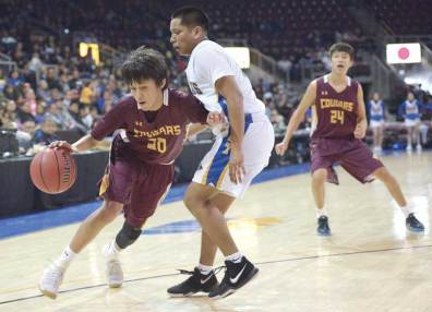 Navajo Times | Donovan Quintero Rock Point's Adrian Johnson (20) drives the ball against guarding Fort Thomas Apache Malachi Rogers Saturday in the Arizona 1A boys state quarterfinals at the Prescott Valley Events Center.