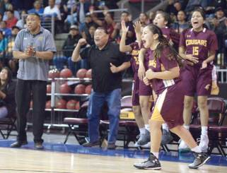 Navajo Times | Donovan Quintero Rock Point Lady Cougar Tamarrah Deswood, front right, runs onto the court as she cheers on her teammates' score Saturday during the Arizona 1A girls state quarterfinals against the Fort Thomas Lady Apaches at the Prescott Valley Events Center in Prescott Valley, Arizona.