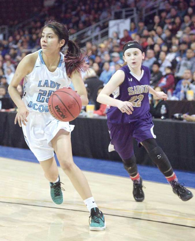 Navajo Times | Donovan Quintero Window Rock Lady Scout Venessa James drives the ball by a Sabino Lady Sabercat defender as she makes her way for the basket Monday evening during the 3A girls state tournament quarterfinal game in Prescott Valley, Arizona.