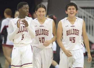 Navajo Times | Donovan Quintero Winslow Bulldogs teammates Yoann Djassa (5), Ricardo Villanueva (40) and Zach Wagner (45) celebrate their win over the Florence Gophers in the Arizona 3A boys state quarterfinals at the Prescott Valley Events Center in Prescott Valley, Arizona Tuesday evening.