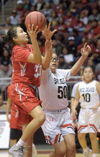Navajo Times | Donovan Quintero Monument Valley Lady Mustang Lakeshia Begay, left, sets for a shot as Page Lady Sand Devil Jacey Salabiye (50) attempts to thwart her on Monday during the Arizona 3A girls championship game at the Gila River Arena in Glendale, Arizona. Page defeated the Mustangs, 44-41, to win first place.