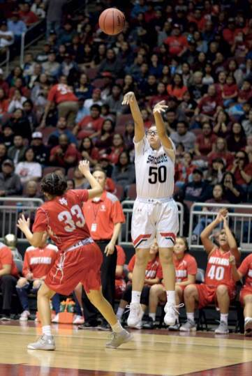 Navajo Times | Donovan Quintero Page's Jacey Salabiye (50) shoots the ball from the 3-point line as Monument Valley Lady Mustang Lakeshia Begay (33) looks on Monday in Glendale, Ariz.