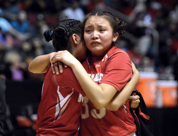 Navajo Times | Donovan Quintero Lady Mustang Lakeshia Begay hugs her teammate after being defeated by the Page Lady Sand Devils on Monday in Glendale, Ariz.