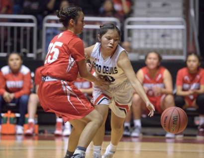 Navajo Times | Donovan Quintero Lady Sand Devil Mikala Benally, white jersey, goes after the ball while Monument Valley's Adriana Sheppard guards her during the Arizona 3A girls championship game in Glendale, Ariz.