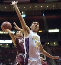 Navajo Times | Donovan Quintero Yellow Jacket Darrien Burnette (15) misses a chance to block Winslow Bulldog Darius James' shot Monday at the Gila River Arena in Glendale, Ariz.