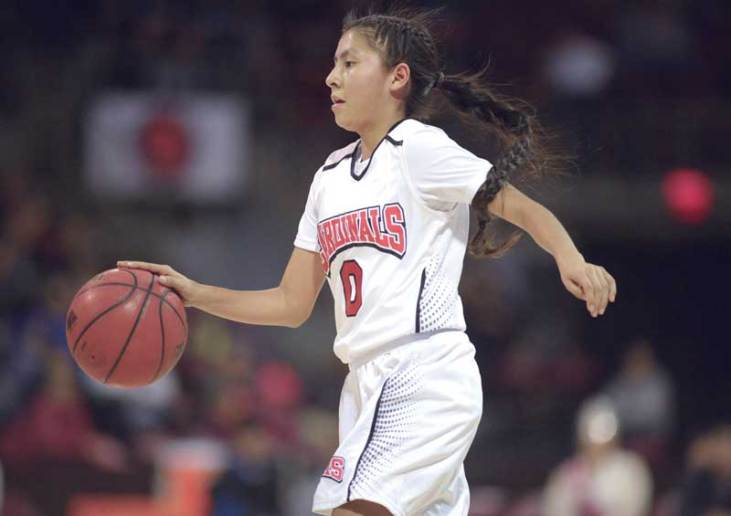 Navajo Times | Donovan Quintero Lady Cardinal Ali Upshaw dribbles down the court on Saturday during the Arizona 1A girls championship game against the Baboquivari Lady Warriors at the Prescott Valley Events Center in Prescott Valley, Ariz.