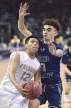 Navajo Times | Donovan Quintero Alchesay Falcon Tyreck Cosay (12) takes the ball to a Rancho Solano Prep Akram Hachem (right) Saturday in Prescott Valley, Ariz.