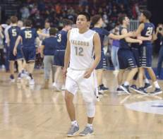 Navajo Times | Donovan Quintero Alchesay Falcon Tyreck Cosay (12) walks to sideline as the final buzzer goes off during the Arizona 2A boys championship game in Prescott Valley, Ariz.