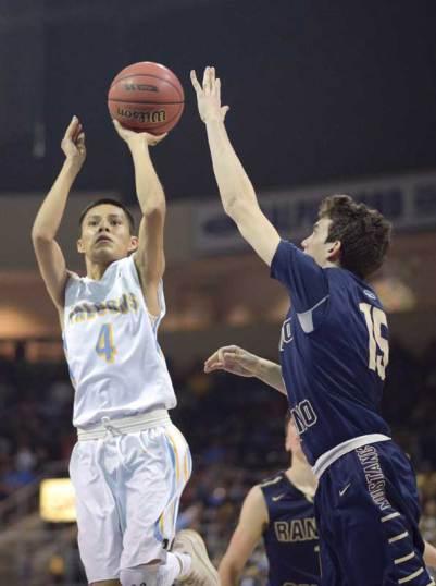 Navajo Times | Donovan Quintero Alchesay Flacon Jerron Daley (4) aims the ball for the basket as a Rancho Solano Prep Mustang defender tries to block his shot on Saturday in Prescott Valley, Ariz.