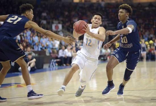 Navajo Times | Donovan Quintero Alchesay's Tyreck Cosay (12) takes the ball between a pair of Rancho Solano Prep Mustang defenders on Saturday.