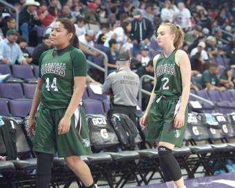 Navajo Times | Donovan Quintero Flagstaff Lady Eagles Danell Lipscomb (14) and Ashley Edison make their way to the locker room Monday during the Arizona 4A girls semifinals against the Pueblo Magnet Lady Warriors at the Grand Canyon University gymnasium in Phoenix.