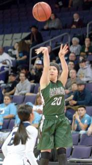 Navajo Times | Donovan Quintero Flagstaff Lady Eagle Emma Doskicz (20) makes a 3-point attempt as a Lady Warrior defender looks on Monday during the Ariziona 4A girls semifinals in Phoenix. Flagstaff lost, 52-32.