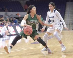 Navajo Times | Donovan Quintero Flagstaff's Monique Ware keeps a Pueblo Magnet Lady Warrior defender away Friday in Phoenix.