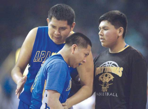 Navajo Times | Donovan Quintero Fort Thomas Apache Latrell Titla lends a supporting hand to teammate Malachi Rogers after they are defeated, 65-46, by the Gregory School Hawks in the Arizona 2A boys championship game at the Prescott Valley Events Center in Prescott Valley, Ariz.
