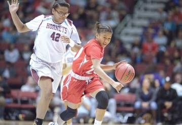 Navajo Times | Donovan Quintero Monument Valley's Jazlyn Lane, right, runs down the court as Ganado's Michelene Coleman (42) runs after her Friday in Glendale, Ariz.