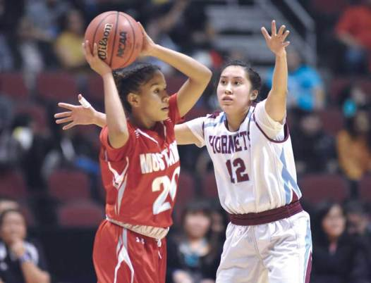 Navajo Times | Donovan Quintero Ganado Lady Hornet Jayla Mcintosh (12) holds her arms over Lady Mustang Jazlyn Lane Friday during the Arizona 3A girls semifinals in Glendale, Ariz.