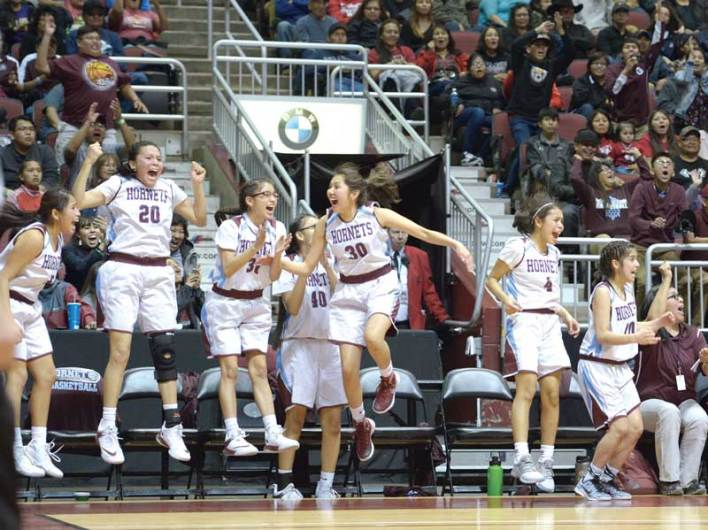 Navajo Times | Donovan Quintero The Ganado Lady Hornets leap on the sidelines Friday during the Arizona 3A girls semifinals against the Monument Valley Lady Mustangs at the Gila River Arena in Glendale, Ariz.