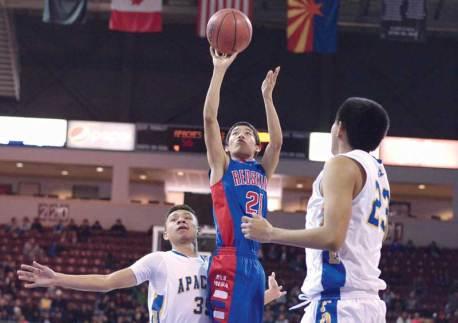 Navajo Times | Donovan Quintero Red Mesa's Hunter Pipkin (21) shoots the ball over Fort Thomas Apaches Jayven Elgo, left, and Kobe Tango (23) Friday in Prescott Valley, Ariz.
