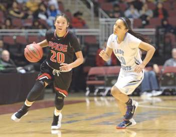 Navajo Times | Donovan Quintero Page Lady Sand Devil Myka Taliman (20) drives by defending Window Rock Lady Scout Rayel Holyan Saturday at the Gila River Arena in Glendale, Ariz.