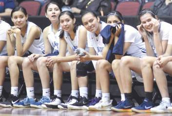 Navajo Times | Donovan Quintero The Window Rock Lady Scouts smile as the lead over them increases when a Page Lady Sand Devil adds two points to the score Saturday during the Arizona 3A girls semifinals at the Gila River Arena in Glendale, Ariz.