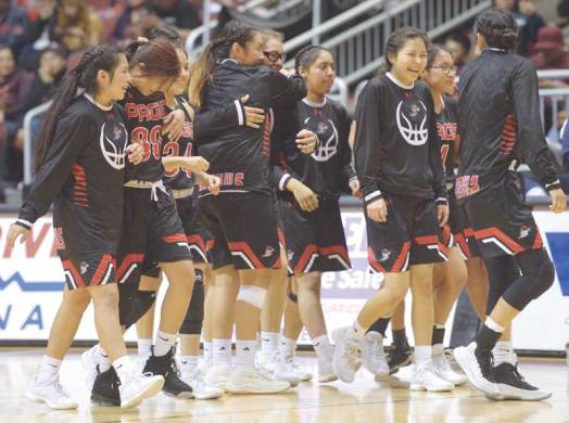 Navajo Times | Donovan Quintero The Page Lady Sand devils celebrate their victory over the Window Rock Lady Scouts Friday in Glendale, Arizona.