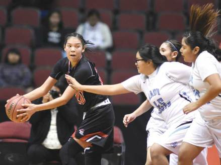 Navajo Times | Donovan Quintero Page's Myka Taliman, left, grabs the loose ball Friday during the Arizona 3A girls semifinals against the Window Rock Scouts in Glendale, Ariz.