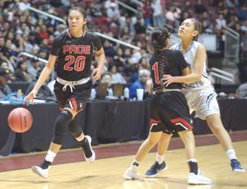 Navajo Times | Donovan Quintero Page's Ashlyn Adakai (1) blocks Window Rock's Rayel Holyan, and opening the path to the basket for teammate Myka Taliman (20) Saturday in Glendale, Ariz.