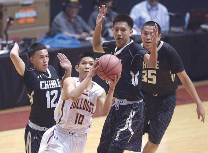 Navajo Times | Donovan Quintero Winslow Bulldog Darius James (10) takes the ball by Chinle Wildcat Josiah Tsosie (12) and his teammates Friday during the Arizona 3A boys semifinals in Glendale, Ariz.