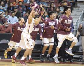 Navajo Times | Donovan Quintero The Winslow Bulldogs begin to celebrate their 68-57 win over the Chinle Wildcats Saturday in the Arizona 3A semifinal in Glendale, Ariz.
