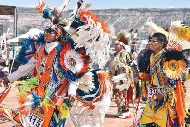Navajo Times | Rima Krisst Fancy dancers during grand entry on Sunday at the Navajo Nation Fair powwow.