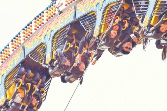 "Navajo Times | Krista Allen Youngsters from schools across Western Navajo enjoy a ride on ""Fire Ball"" during Kids Day at the 50th annual Western Navajo Fair on Oct. 11."