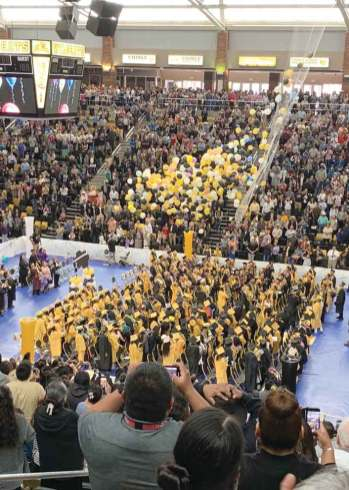 Navajo Times | Cindy Yurth An avalanche of balloons rains down on Chinle High School's 210 graduates in the Wildcat Den Saturday.