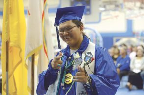 Navajo Times | Donovan Quintero Navajo Pine High graduate Monroe Keedo makes his way to the stage during his graduation on Saturday in Navajo, N.M.